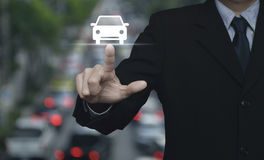 Business service car concept. Businessman pressing car flat icon over blur of rush hour with cars and road, Business transportation service concept Stock Image