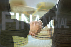 Business shaking hand on finacial graph background. Royalty Free Stock Photography