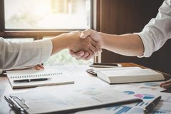 Business Shaking Hands After Discussing Good Deal Of Trading To Royalty Free Stock Image