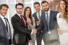 Business shaking hands with business partner. The concept of teamwork stock image