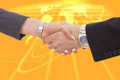 Business shaking hands in front of earth map Royalty Free Stock Images