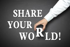 Business share your world concept. Share your world concept with businessman hand holding against blackboard background stock photography