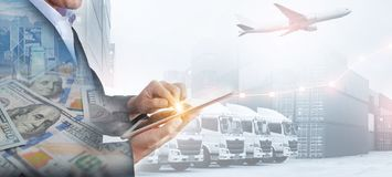Business, shipping industry and transportation background by business man is using technology tablet to command logistics. Method royalty free stock images