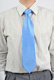 Business shirt and tie. Detail of white shirt and blue tie Stock Photography