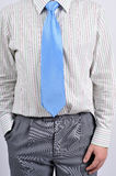 Business shirt and tie. Detail of white shirt and blue tie Royalty Free Stock Image