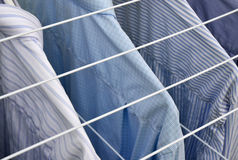 Business shirts drying, businessman blue shirts Royalty Free Stock Photos