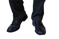 Business shoes. A business man starting to walk royalty free stock photo