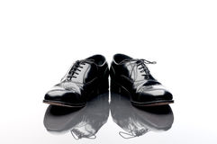 Business shoes on a reflective surface Stock Images