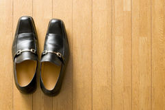 Business shoes on wooden floor. Still life photography Royalty Free Stock Photos