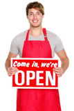 Business shop owner showing open sign Stock Photography