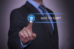 Business Shopping Add to Cart. Working with virtual screen touch internet Stock Photo