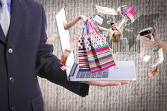 Business show shopping concept with his laptop Royalty Free Stock Photo