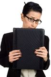 Business Shy. Female holding briefcase looking shy stock photo