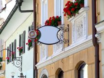 Business sign. Sign on a house in alpine town Stock Photo