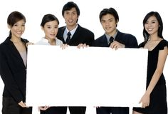 Business Sign. A group of asian businesswomen and men holding a large blank sign on white background Stock Photo