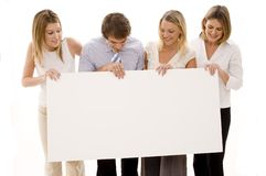 Business Sign. Four young executives holding a big blank sign Royalty Free Stock Photography