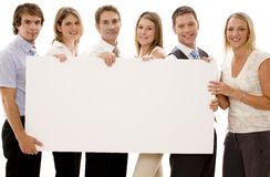 Business Sign. Six business men and women holding a big blank sign Stock Photography
