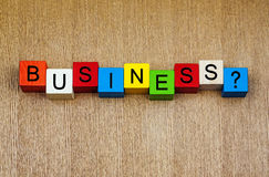 Business - sign on building blocks. Question, definition, strategy, success stock photography