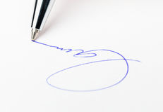 Business signature. Signing the paper with ballpoint pen Stock Photography
