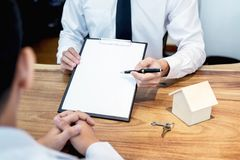 Business Signing a Contract Buy - sell house, insurance agent an. Alyzing about home investment loan Real Estate concept Royalty Free Stock Photography