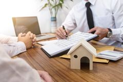 Business Signing a Contract Buy - sell house, insurance agent an. Alyzing about home investment loan Real Estate concept Stock Images