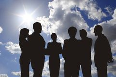 Business silhouette on sunny sky Royalty Free Stock Image