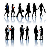 Business silhouettes Stock Images
