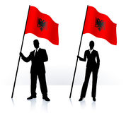 Business silhouettes with waving flag of Albania Stock Photography