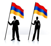 Business silhouettes with waving flag of Armenia Stock Photo