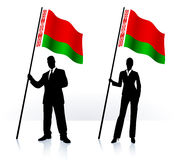 Business silhouettes with waving flag of Belarus Royalty Free Stock Images