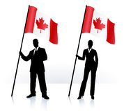 Business silhouettes with waving flag of Canada Stock Image