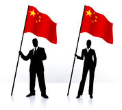 Business silhouettes with waving flag of China Royalty Free Stock Image