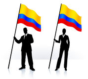 Business silhouettes with waving flag of Columbia Stock Photo