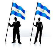 Business silhouettes with waving flag of El Salvador Royalty Free Stock Photos
