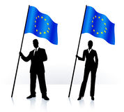 Business silhouettes with waving flag of European Union Stock Image
