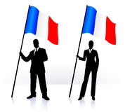 Business silhouettes with waving flag of France Stock Photo