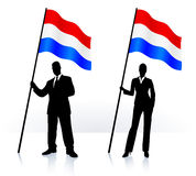 Business silhouettes with waving flag of Holland Royalty Free Stock Photo
