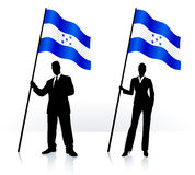 Business silhouettes with waving flag of Honduras Royalty Free Stock Image