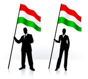 Business silhouettes with waving flag of Hungary Royalty Free Stock Photography