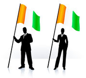 Business silhouettes with waving flag of Ireland Stock Photos