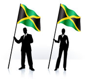 Business silhouettes with waving flag of Jamaica Stock Photos