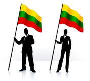 Business silhouettes with waving flag of Lithuania Royalty Free Stock Photo