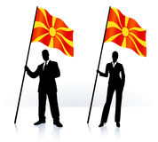 Business silhouettes with waving flag of Macedonia Royalty Free Stock Photos