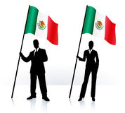 Business silhouettes with waving flag of Mexico Royalty Free Stock Image