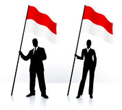 Business silhouettes with waving flag of Monaco Stock Photo