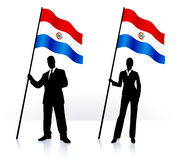 Business silhouettes with waving flag of Paraguay Stock Photography