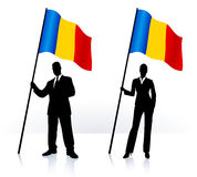 Business silhouettes with waving flag of Romania Stock Images