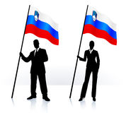 Business silhouettes with waving flag of Slovenia Royalty Free Stock Image