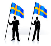 Business silhouettes with waving flag of Sweden Royalty Free Stock Image