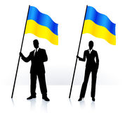 Business silhouettes with waving flag of Ukraine Royalty Free Stock Image